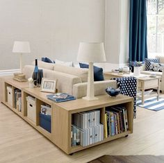 short bookcase wraps around the sofa