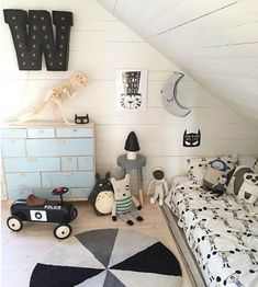 Black, white and grey kids room with a dash of light blue - a cool and playful room