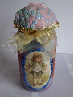 Jar by Fgasior on Etsy.Handmade altered jar. Decorated withVintage picture ,paint and gliter