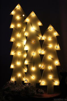 wooden christmas trees with lights rustic christmas