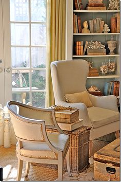 neutral coastal chic, adore the pop of blue in the back of the bookcase