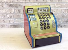Old Tin Toy Cash Register.    Misinterpreted on Etsy