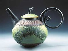 Beautiful handmade teapot.  Makes me wanna learn how to throw clay!