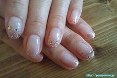 It is a lame French pink gold.  It is a simple and glamorous nail rhinestone studded snow as the tip.