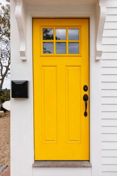 Painting your front door is an inexpensive and easy way to freshen up a home's curb appeal. Bright Front Doors, Orange Front Doors, Unique Front Doors, Best Front Doors, Orange Door, Front Door Paint Colors, Yellow Doors, Painted Front Doors, Front Door Design