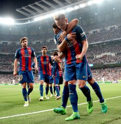 Ivan Rakitic of Barcelona celebrates as he scores their second goal with Luis Suarez during the La Liga match between Real Madrid CF and FC Barcelona at Estadio Bernabeu on April 2017 in Madrid, Spain. Sergi Roberto, Messi And Ronaldo, Club, Fc Barcelona, Real Madrid, Soccer, Football, Running, Celebrities
