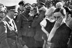 Hitler visits his advancing troops in Poland and pauses to speak with ethnic German villagers, who are welcoming the German troops as liberators. The villagers are crying and the Liberator is ready with his usual boosting words, Sept 1939.