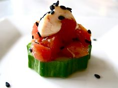 Tuna Tartare on Cucumber Rounds with Spicy Mayonnaise and Toasted Black Sesame Seeds