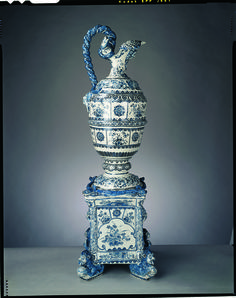There are still ten large vessels (including the two pairs shown here) and three smaller pieces at Hampton Court, all of which were supplied directly to Queen Mary by Adriaen Kocks's factory. (A bill for £122 14s. 9d. for 'Dutch China ware' supplied by Kocks was paid after the Queen's death in 1694.) They were probably designed by William and Mary's court architect, Daniel Marot (1663-1752), who may have been inspired by seventeenth-century French silver for some of the shapes. Many of Queen…