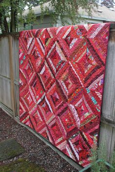"This quilt will certainly brighten up a room on a dark winter day! This pretty red string quilt is not only lovely to look at but it is foundation pieced for durability and added warmth. This is such a special quilt for the one in your life that can't get enough red! Every decadent shade is found in this quilt.  This quilt measures 68"" x 89"". The perfect size for use on a twin bed or for movie night at home."