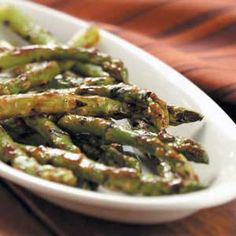 Grilled Asparagus Recipe -Tender, with a delicious barbecue flavor, these asparagus spears make a perfect side dish for grilled meats. For easy grilling, place asparagus on a double skewer. —Taste of Home Test Kitchen