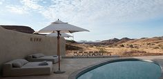 Damaraland Camp, Torra Conservancy offers spacious adobe-styled, thatched units in the most pristine wilderness area of Namibia. Wilderness, Safari, Coast, African, Camping, Patio, Building, Skeleton, Outdoor Decor