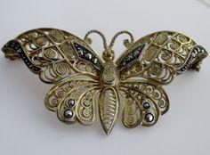 http://www.ebay.com/itm/Fine-Estate-Gilt-Sterling-Silver-M-BE-Butterfly-Brooch-Pin-w-Marcasites-2-6-15g-/351343965894