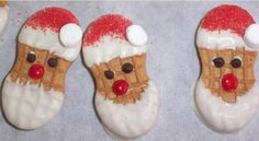 Nutter Butter Santa cookie faces. Use white icing, chocolate chips for eyes, red hots for the nose, red sugar sprinkles for the hat and miniature marshmallow for the ball on Santa's hat.