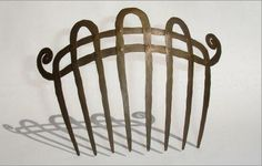 Hair Comb |  Alexander Calder.  Brass. ca 1966.  Sold for 30'000$