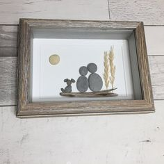 This Couple with Dog Pebble Art piece is made from gatherings our family has made from the shores of Lake Huron, Ontario, Canada. Housed in a rustic wood shadow box frame, this pieces interior measurements are 5x7 and exterior measurements are 6x8. It can hang on a wall or stand on its
