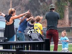 David and Victoria Beckham With Kids in California. Wow that's an Ox jersey!