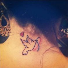 The adorable bird in this tattoo comes bearing a gift -- the ribbon of remembrance.