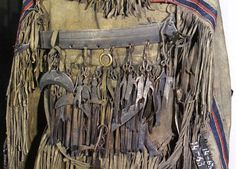Iron protective objects on a late 19th Century Evenk shaman's coat. www.3Worlds.co.uk