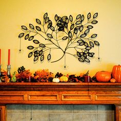 BHG.com: Fall Mantel Decorating Ideas - Tree Theme Mantel Craft (Page 28/29) -- The tree can be done with toilet paper tubes cut into sections, glued together, and painted black! looks just like faux-wrought iron! ~ Oh My Goodness, a way to recycle/reuse toilet and paper towel rolls!  I always have tons in the recycle bin!