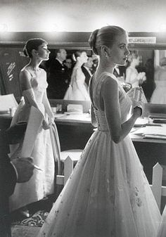 Audrey Hepburn and Grace Kelly backstage at the 1956 Oscars