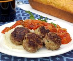 Frikkadel are a lightly spiced South African meatball that are often served with a sweet and herby tomato sauce, making a wonderfully comforting dinner. Mince Recipes, Meatball Recipes, My Recipes, Beef Recipes, Meatball Bake, Recipies, South African Dishes, South African Recipes, Ethnic Recipes