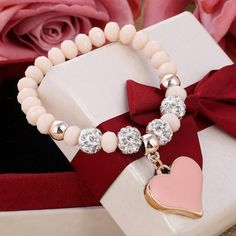 Show your style with our Heart Charm Crystal Bracelet. Available in a range of colours each bracelet is made with crystal beads and gold heart charm. Perfect accessory or a great gift idea for someone special. Material: Zinc Alloy and Crystal