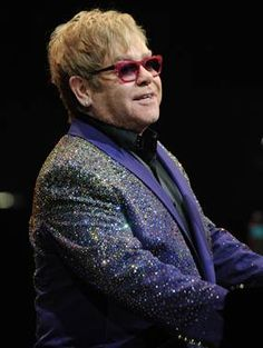 Elton John was released from hospital Thursday after canceling four concerts (Larry Marano / Getty Images)
