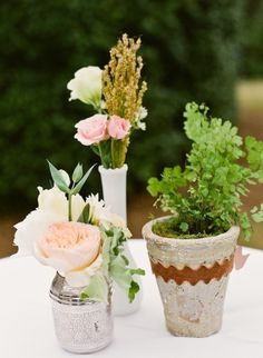 3 small things on one table? ... or what about 1 small potted plant/antique vase with flowers to use as centerpiece and then for each couple to take at end for favor?