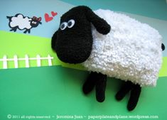 Sheep made with unused faux-wool car wash mitt, an old pair of black fleece mitts, and an old pair of black chenille gloves