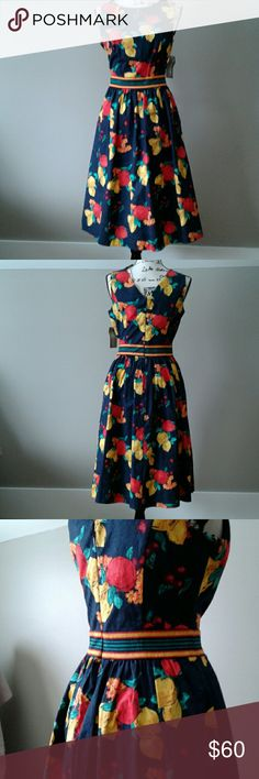 Eva Mendes fit and flare dress 97% cotton, 3% spandex, navy blue with fruit print, midi fit and flare dress. Very flattering. Round neck, V cut at the back. Brand new never worn, smoke free pet free environment. New York & Company Dresses Midi
