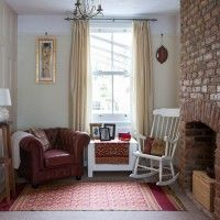 Neutral living room with red furniture