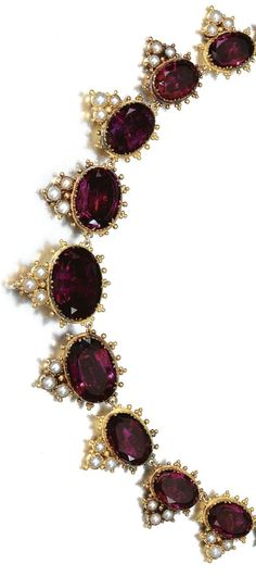 (THE NECDLACE) GOLD AND GEM-SET PARURE, CIRCA 1825 Comprising: a necklace, brooch and bracelet set with foil backed faceted amethyst, pearls and gold bead work, and three later drops set with pear-shaped amethyst, two mounted as earrings and one as drop on brooch, necklace length approximately 410mm, bracelet length approximately 176mm, earrings with hook fittings, later alterations, fitted cases, Hunt Roskell, part illustrated.