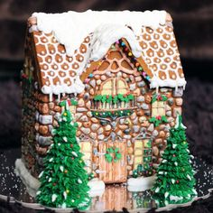 Gingerbread house with royal icing and sprinkles.