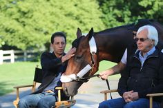Jockey Victor Espinoza shares a moment with American Pharoah after winning the Triple Crown.