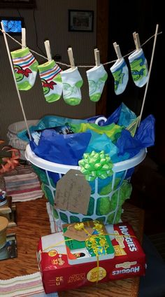 Baby boy shower gift ideas Ninja Turtle theme clothesline. Items include laundry detergent stain remover hangers delicates bag outfits decorations for nursery .any odd and end baby stuff you can think of works great In this gift!