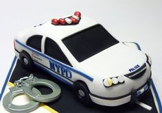 Nypd A cake for a recent graduate of the NYPD academy. Car is sculpted from RKT and covered in fondant/gumpaste details. Handcuffs and...