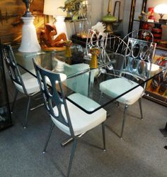 Chrome Base Glass Top Table and Set of Four Chrome and Leather Chairs