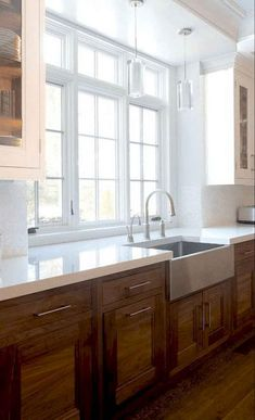 wood kitchen cabinets Galley Kitchen Window with white countertops over medium wood cabinets and mat Dark Wood Kitchen Cabinets, Dark Wood Kitchens, Wood Floor Kitchen, Modern Farmhouse Kitchens, Painting Kitchen Cabinets, Kitchen Flooring, White Cabinets, Kitchen Sink, Kitchen White