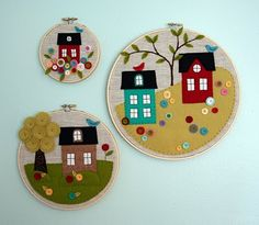 Beautiful trio of little appliqued felt houses in embroidery hoops