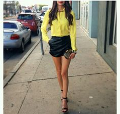 Love the yellow top and black leather skirt black heels.