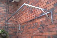 Aluminium wall mounted fold down washing lines. For both indoor Aluminium wall mounted fold do Diy Washing Lines, Outdoor Washing Lines, Outdoor Clothes Lines, Outdoor Laundry Rooms, Small Laundry Rooms, Laundry Room Design, Outdoor Walls, Drying Rack Laundry, Clothes Drying Racks