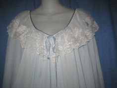 "LUCIE-ANN-NIGHTGOWN-GORGEOUS-FEMININE-SUPER-SILKY-NYLON ELEGANT DELIGHTFUL PALE PASTEL BLUE M-L ESPECIALLY PRETTY WHITE LACE GENTLY ELASTICIZED AT CUFFS 100% SUPER SILKY NYLON MADE IN THE USA VERY AMPLE ARMHOLES! SIZE: MEDIUM - LARGE (NO SIZE TAG) ELEGANT 55"" LENGTH 44"" BUST 100%  NYLON THIS WONDERFUL NIGHTGOWN IS IN VERY NICE VINTAGE CONDITION #38"