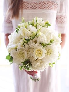 white peonies, white hydrangea, white stock, white roses, white ranunculus, soft green liisanthus, accented with a touch of dusty miller. - per Tulip's note for your bouquet