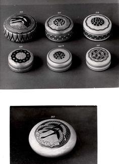 Gustav Gaudernack design, seven enameled silver bonboniere/boxes with stylized plant/swan motifs on enameled gulliochine ground