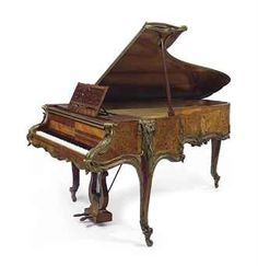 A FINE FRENCH ORMOLU-MOUNTED TULIPWOOD, SATINE AND BOIS DE BOUT MARQUETRY PIANO A QUEUE  THE CASE ATTRIBUTED TO JOSEPH-EMMANUEL ZWIENER, THE MOVEMENT BY ERARD, SERIAL NUMBER 71242, PARIS, CIRCA 1894