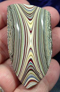 Suzybones Fordite specimen