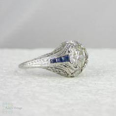 I love sapphires and diamonds.  Ornate Platinum Filigree Engagement Ring. Diamonds & Sapphires in Art Deco Platinum Filigree, Circa 1920s.