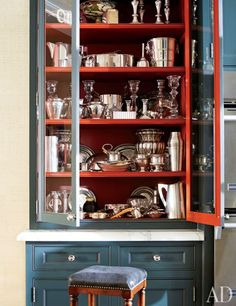 Paint the inside of a cabinet red