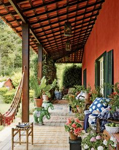 Beautiful orange porch with hammock and lots of plants